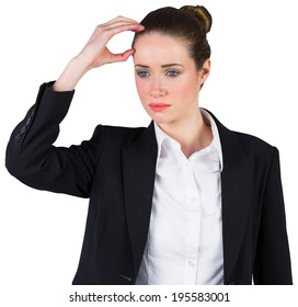 Businesswoman thinking and touching head on white background