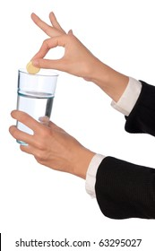 Businesswoman throws a pill from headache to the glass with water