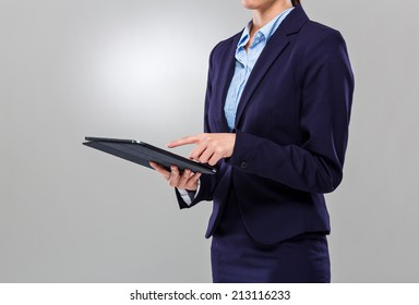 Businesswoman touch on the screen of digital tablet