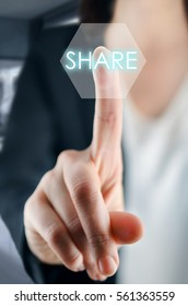 Businesswoman touching share button on virtual screen.