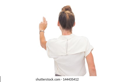 Businesswoman touching something with hand rear view
