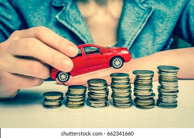 Businesswoman and toy car on coin stack - insurance, loan and buying car concept - retro style