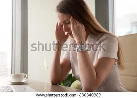 Businesswoman tries to cope with nervous tension or anxiety. Woman suffering from panic attacks or head ache. Girl in depression because of troubles at work. Master emotions, take back control concept