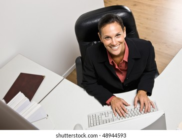 Businesswoman typing on computer