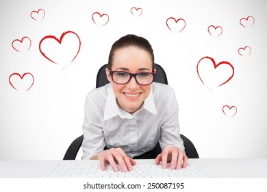 Businesswoman typing on a keyboard against white background with vignette