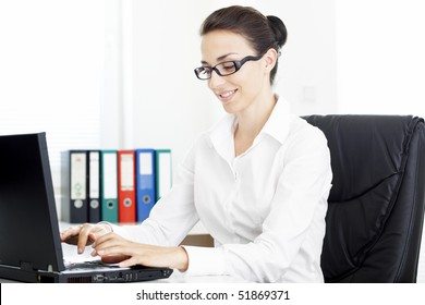 Businesswoman typing on a laptop computer