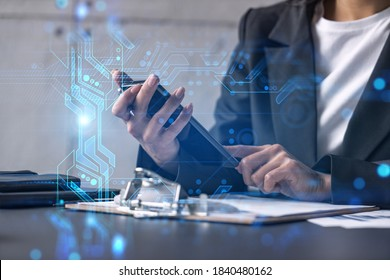 Businesswoman typing phone in office. High-tech hologram. International business concept. Double exposure.