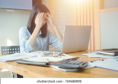 Businesswoman under terrible physical tension at work with head in hands she is having a bad headache,Stressed young woman on the edge of a nervous breakdown.Overwork and stress concept.vintage effect