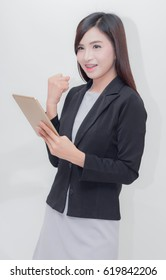 Businesswoman use of mobile phone. young woman used smart phone. Hold hands glad concept success