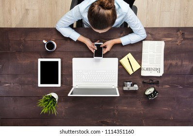 Businesswoman use phone blank screen top view at office