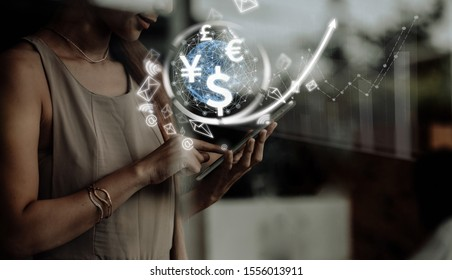 businesswoman uses Smartphone computer, world currencies, wallet cryptocurrency on virtual screen, fintech financial technology, internet payment, money exchange, digital banking concept - Shutterstock ID 1556013911