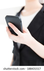 businesswoman using black smart phone