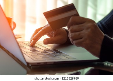 Businesswoman using credit card, typing on keyboard of laptop computer for online shopping and payment at home in free time.Business financial technology,e commerce,e banking, internet banking concept