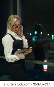 Businesswoman using her digital tablet in office late at night