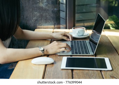 Businesswoman using laptop for business project, smart phone, touchpad, notbook