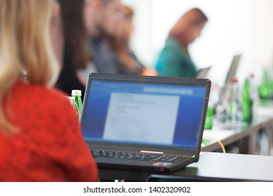 businesswoman using laptop computer at business meeting