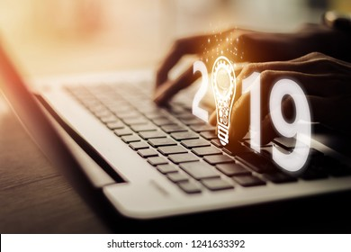 Businesswoman using laptop, searching web, browsing information, having workplace at office /  Business  new year 2019 concept