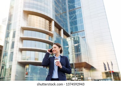 Businesswoman using mobile phone in the city