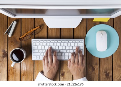 Businesswoman using pc computer on her office table