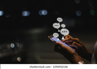 Businesswoman using smartphone at night in the city ,social, media, marketing concept.
