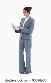 Businesswoman using tablet computer against a white background