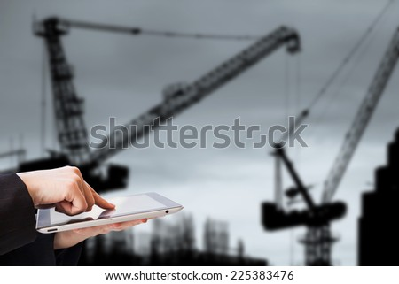 Businesswoman using tablet in construction site