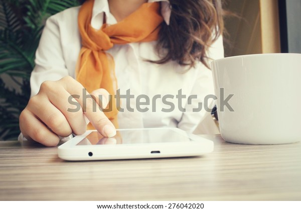 Businesswoman using tablet with drink coffee  in the cafe