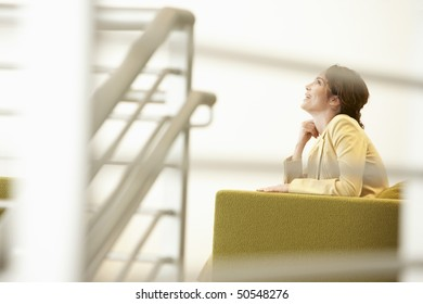 Businesswoman waiting on sofa in office