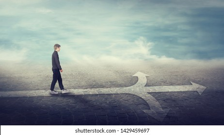 Businesswoman walking on a line in front of a crossroad split in three different ways as road arrows. Choosing the correct pathway between left, right and front directions. Difficult decision concept.