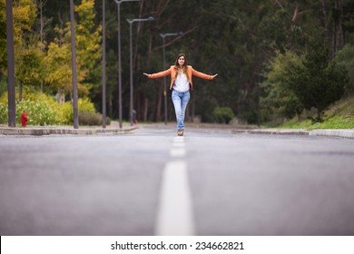 Businesswoman walking on the road