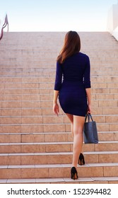 Businesswoman walking up the stairs
