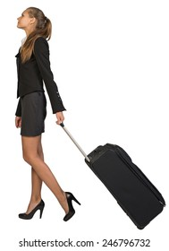 Businesswoman walking with wheeled travel bag. Isolated over white background