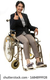 Businesswoman in wheelchair giving thumb up isolated on white background