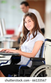 Businesswoman in wheelchair working in the office