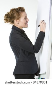 businesswoman at whiteboard