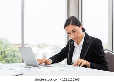 Businesswoman woking on notbook computer laptop in office
