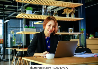 Businesswoman working with business document and laptop computer notebook on the desk in modern workplace, Business and people concept
