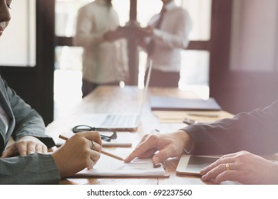 Businesswoman working with businessman. two business people discussing document and idea at meeting. Woman explaining her colleague in office. Conference, discussion, corporate concept