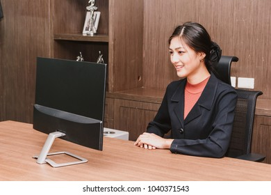 Businesswoman working with computer at modern office