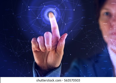 Businesswoman working in futuristic cyberspace hightech environment, hand pushing interface button