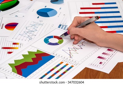 businesswoman working with graphs and charts.