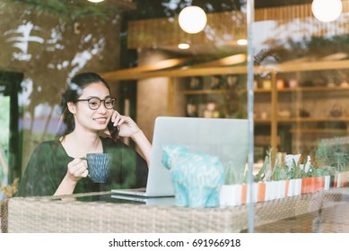 Businesswoman working with laptop in beautiful cafe
