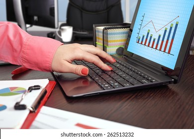 businesswoman working and laptop with forex chart on screen