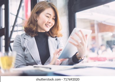 businesswoman working with modern devices, student girl using digital tablet computer and mobile smart phone,business concept,selective focus,vintage color
