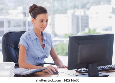 Businesswoman working on her computer in the office