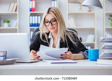 Businesswoman working on laptop at the desk in the office