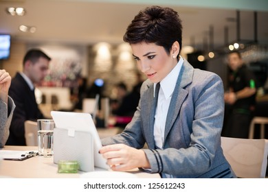Businesswoman working on tablet touch on coffee break