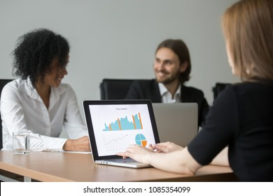 Businesswoman working with project statistics preparing report at team meeting, marketing manager analyzing result, graphs and charts online on laptop screen using business software for data analysis