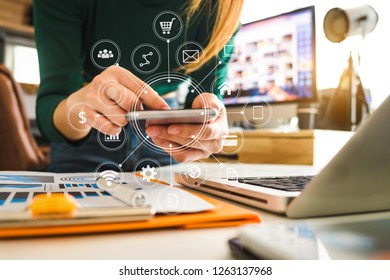 Businesswoman working with smart phone and laptop and digital tablet computer in  office with digital marketing media  in virtual icon