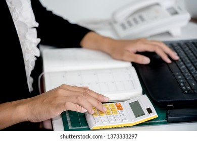 businesswoman working using a calculator in a desk at office